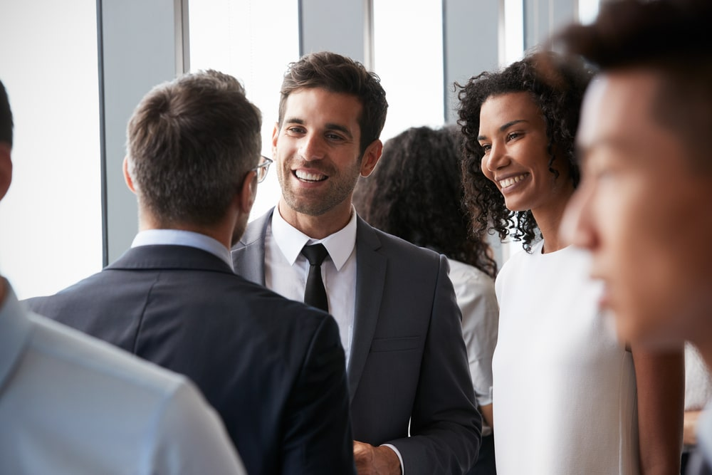 Self-employed business owner networking at event